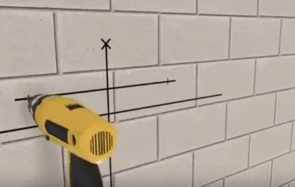 Сверление отверстий на стене