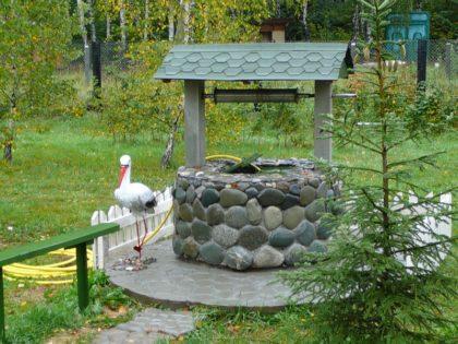 Декоративное оформление колодца из камней
