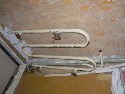 Демонтированный полотенцесушитель